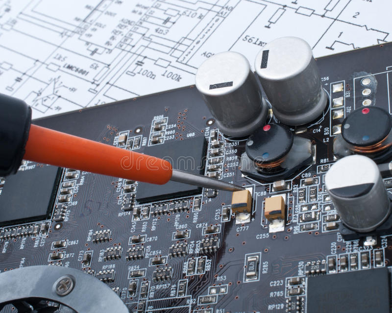 Repair a computer surface-mounted board royalty free stock photography
