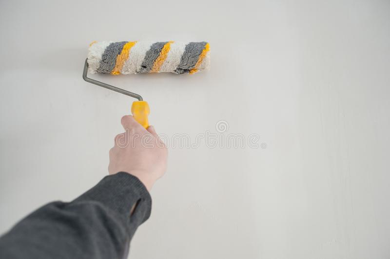 Repair concept, repair tools, priming the wall before laying the tiles on it, the final preparatory stage for strengthening the s. Urface royalty free stock images