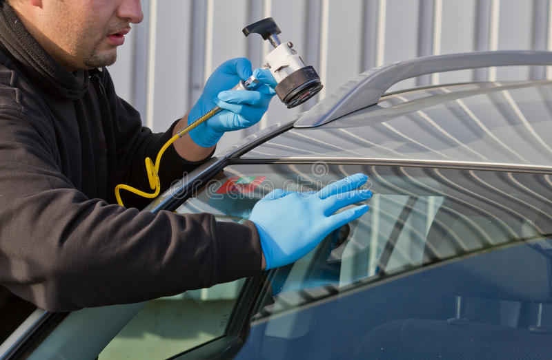 Repair crack in windshield royalty free stock photography