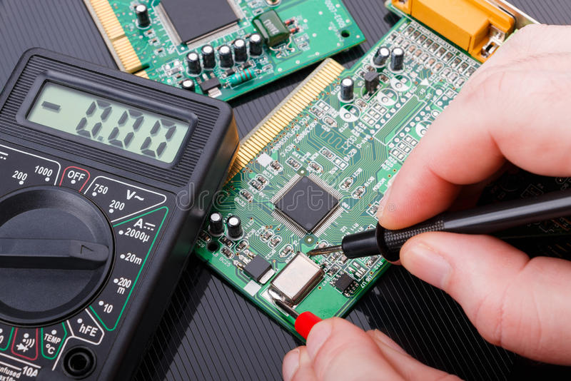 Repair and diagnostic of electronic circuit board. Close-up repair and diagnostic of electronic circuit board stock photos