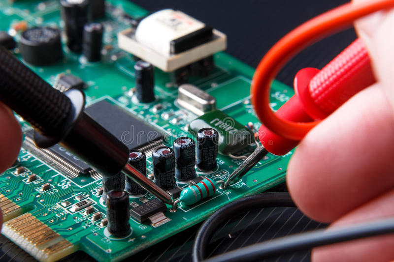 Repair and diagnostic of electronic circuit board. Close-up repair and diagnostic of electronic circuit board stock images