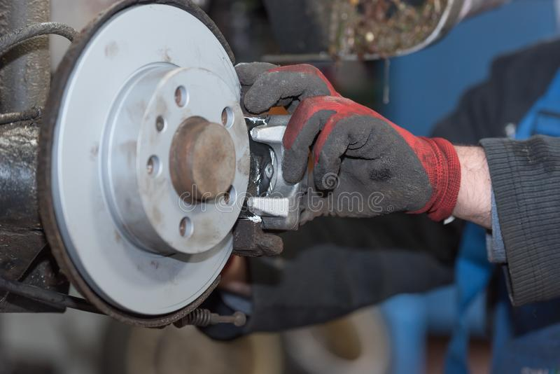 Repair disc brake - hand brake, which have been replaced in the auto repair shop. Repair disc brake - hand brake, which have been replaced in the workshop or in stock photos