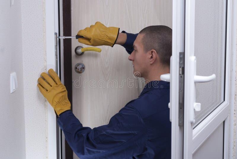 Repair door lock stock photo
