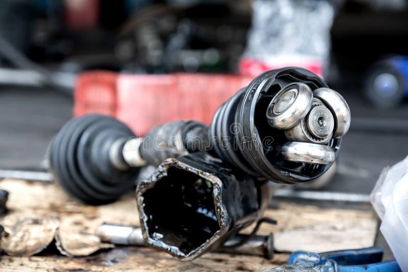 Repair drive shaft CV Joint,Car maintenance. stock photos