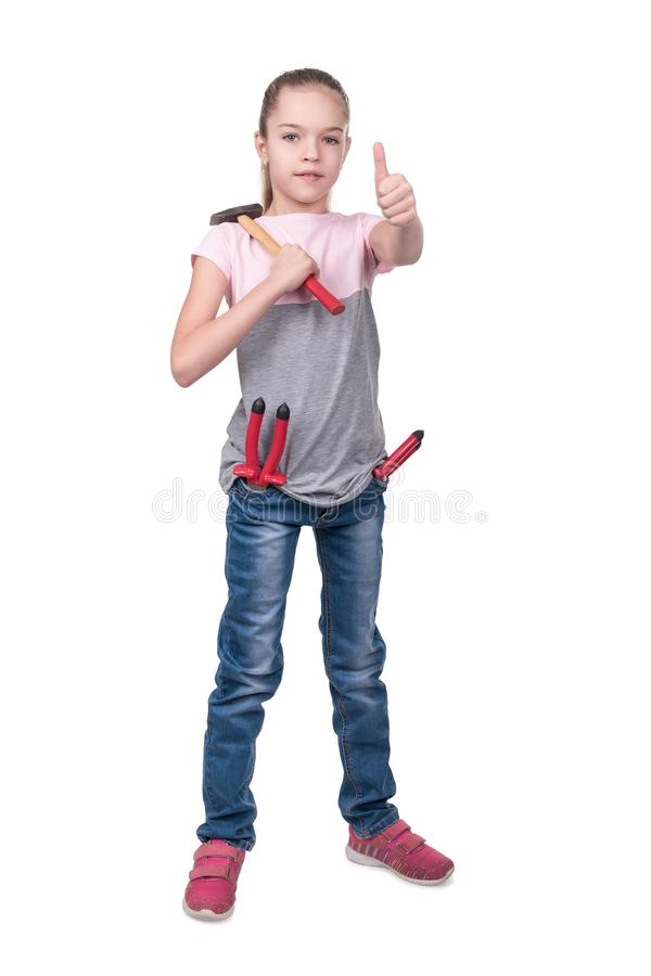 Repair girl with thumb up. Portrait of a girl with tools in pockets and a hammer on her shoulder showing thumb up isolated on white background stock image
