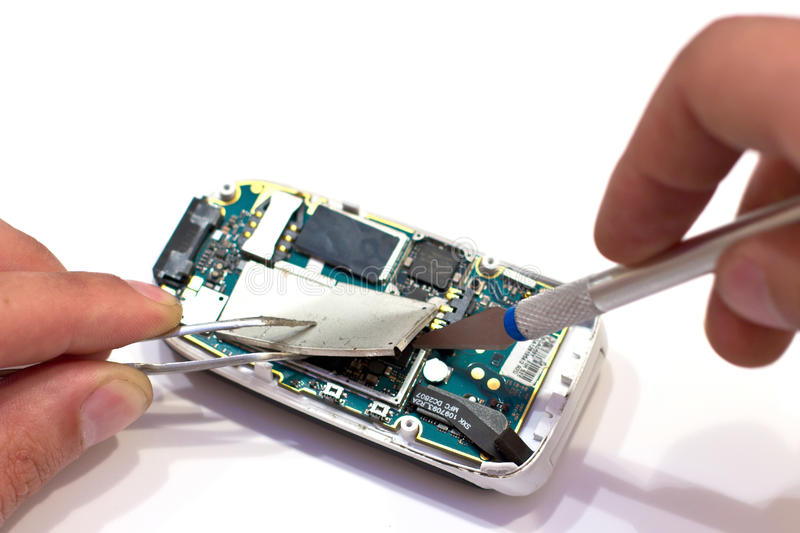 Repair GSM phone. On a white stock photography