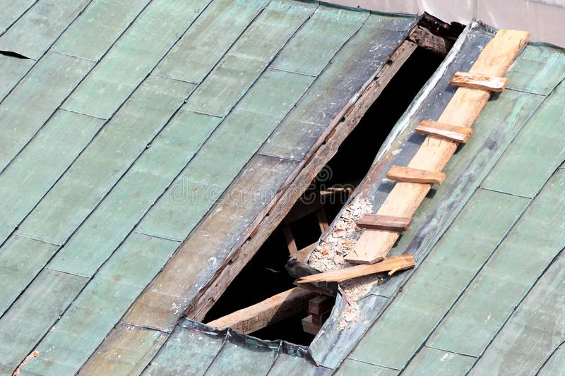 Repair of hole in a metal roof stock photography