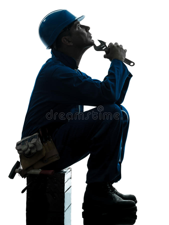 Repair man worker sad fatigue failure silhouette. One caucasian repairman worker sad fatigue failure silhouette in studio on white background stock images
