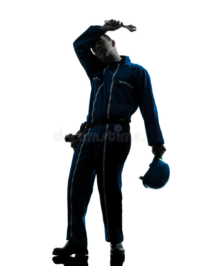 Repair man worker tired fatigue silhouette. One caucasian repairman worker tired fatigue silhouette in studio on white background stock photos
