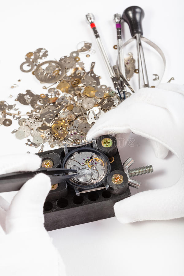 Repair of mechanic watch with spare parts royalty free stock images