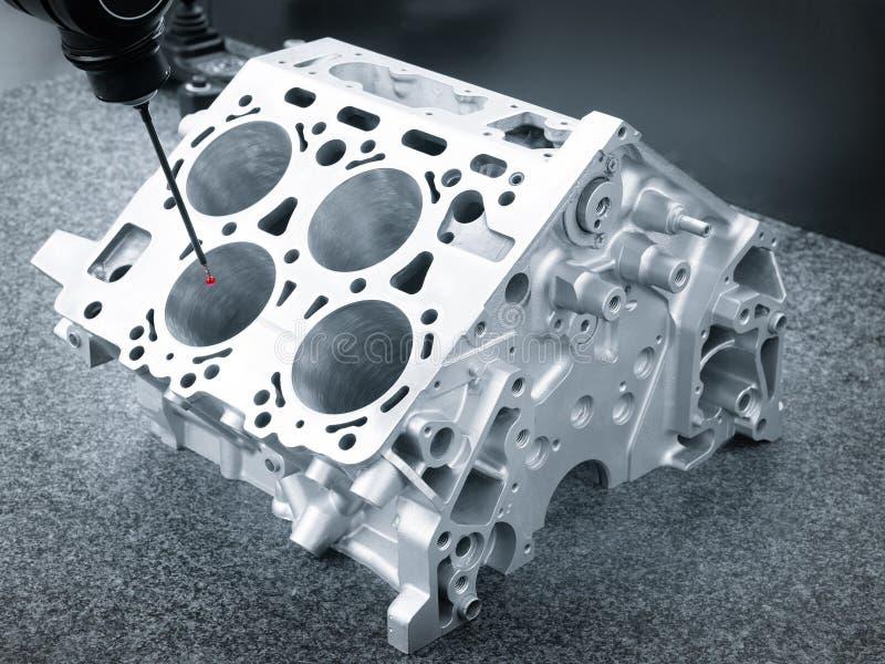 Repair motor block of cylinders, operator inspection dimension aluminium automotive par in industrial factory. Repair motor block of cylinders, operator royalty free stock photo