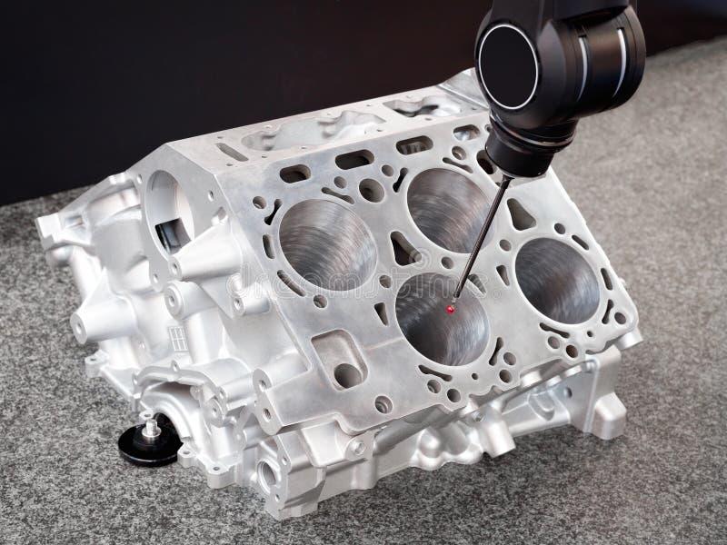 Repair motor block of cylinders, operator inspection dimension aluminium automotive par in industrial factory. Repair motor block of cylinders, operator stock image