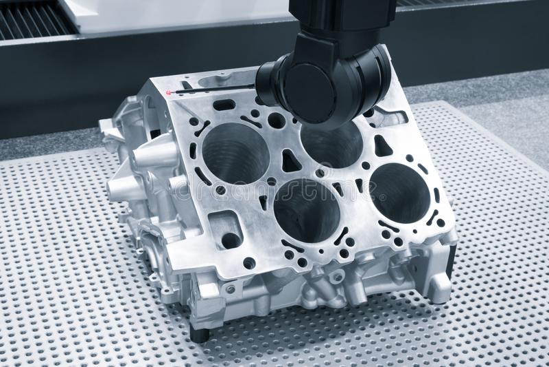 Repair motor block of cylinders, operator inspection dimension aluminium automotive par in industrial factory.  stock images