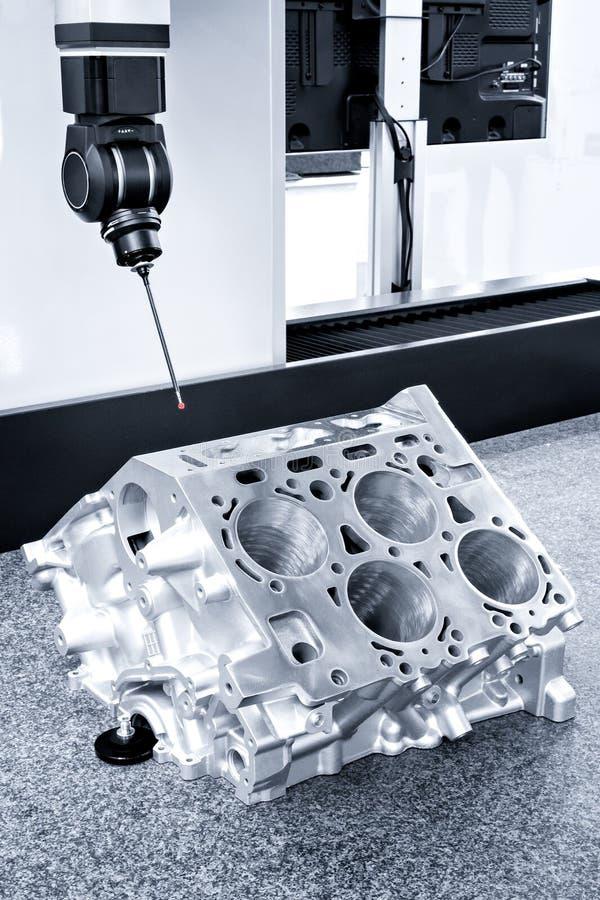 Repair motor block of cylinders, operator inspection dimension aluminium automotive par in industrial factory.  stock photo