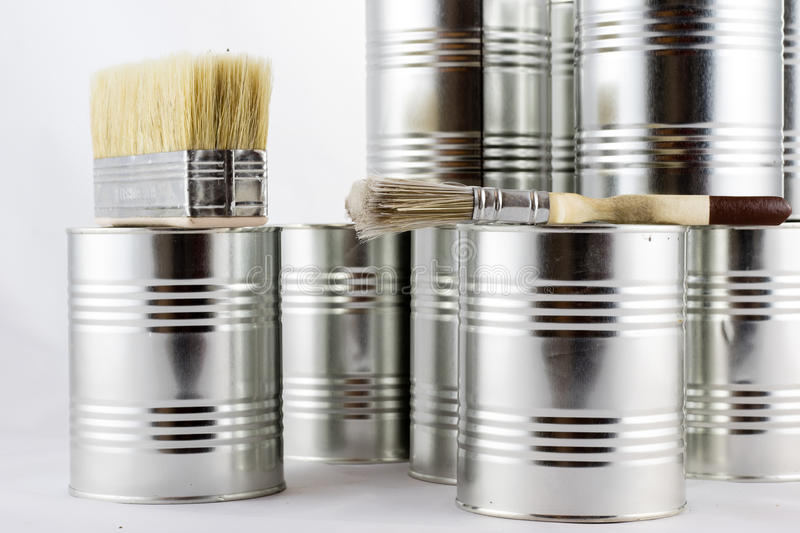 Repair, painting and paint brushes and paint tins on a white iso stock image