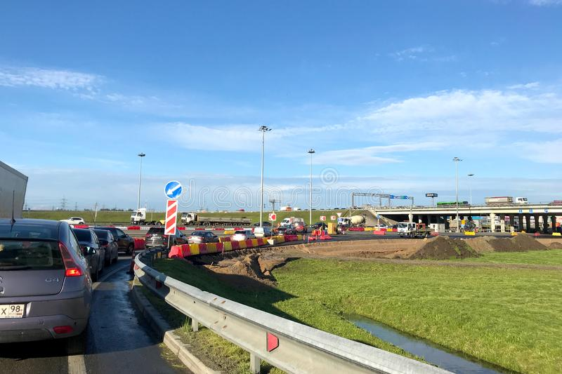 Repair of the ring road, traffic jam from cars stock photo
