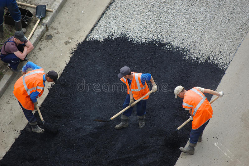 Repair of road covering 2 stock photos