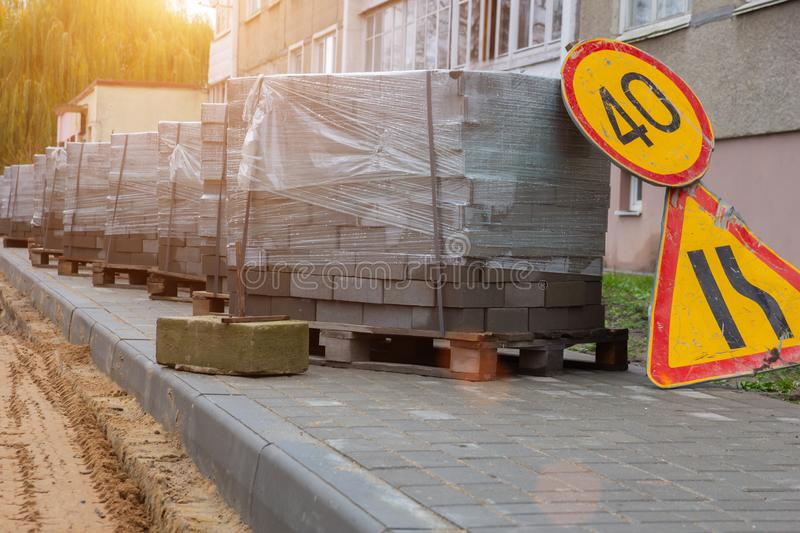 Repair of the road with the help of concrete paving slabs stock photos