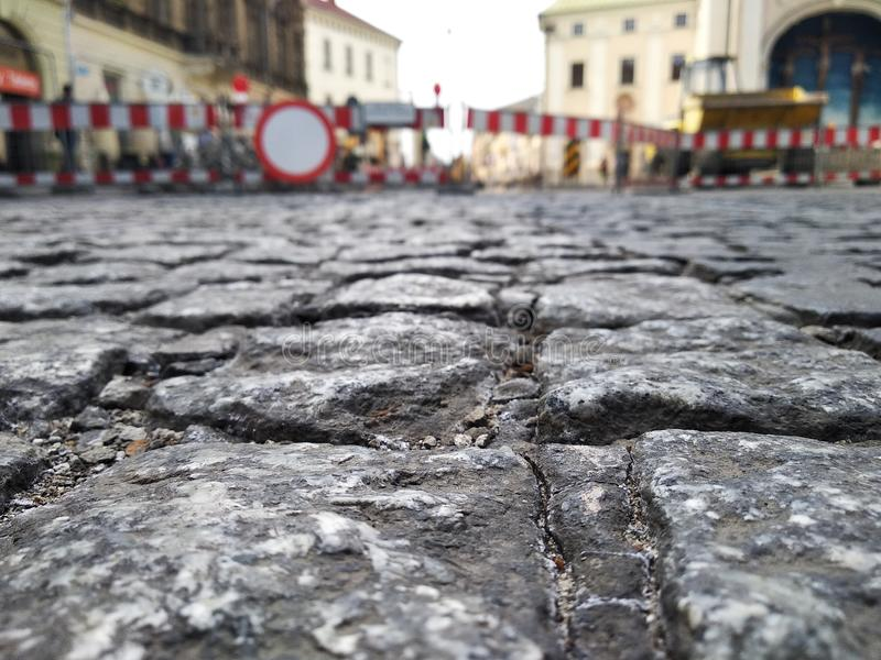 Repair of roads in the Old city. the overlap of the roadway on the background of bars and old buildings, replacement of rails for. Trams, public transport royalty free stock photography