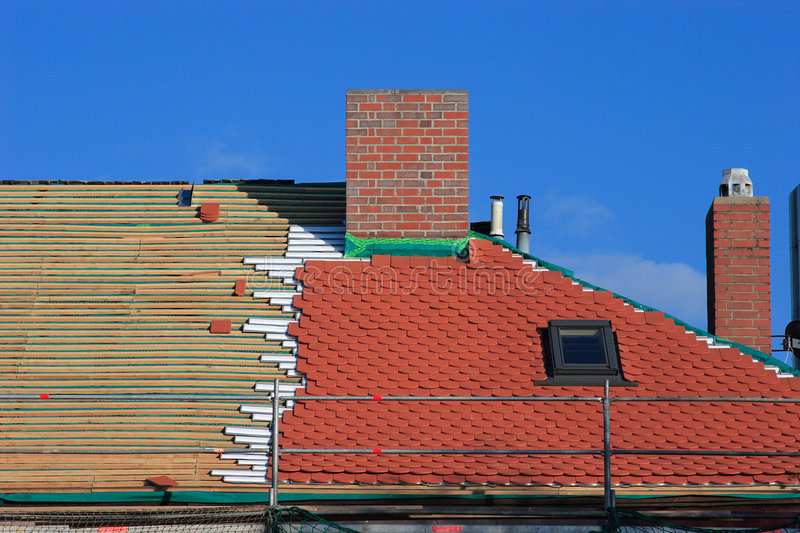 Repair a roof. Repair the roof of an old historical building stock photo