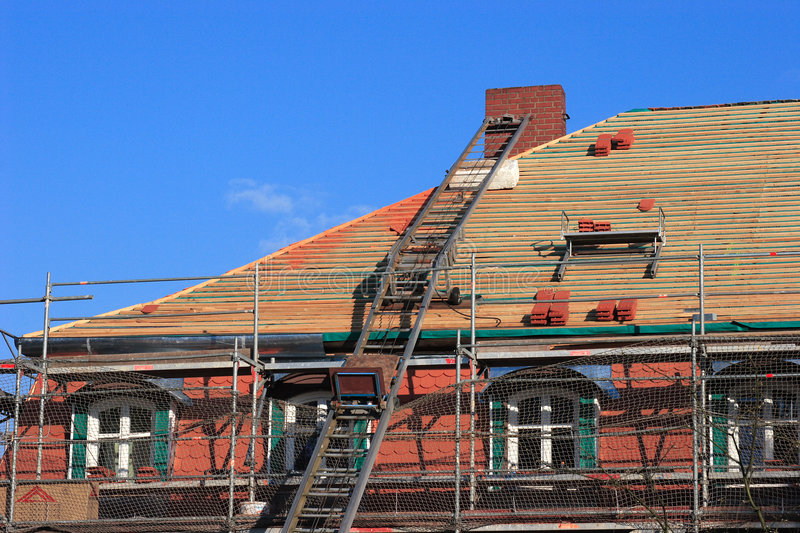 Repair a roof. Repair the roof of an old historical building royalty free stock photo