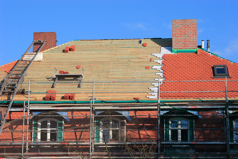 Repair a roof. Repair the roof of an old historical building royalty free stock photography