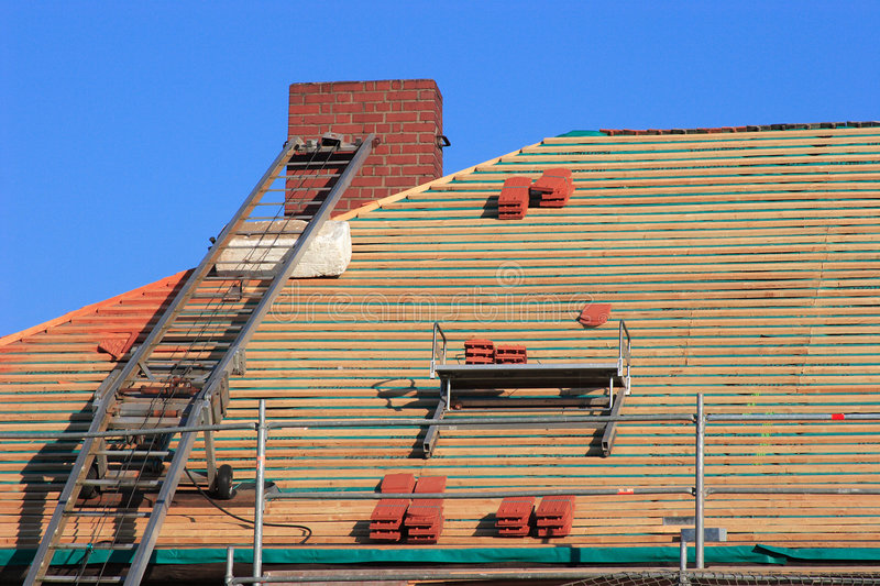 Repair a roof. Repair the roof of an old historical building stock image
