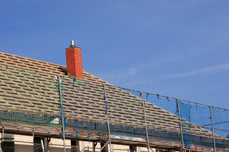 Repair a roof. Repair the roof of an old building stock images