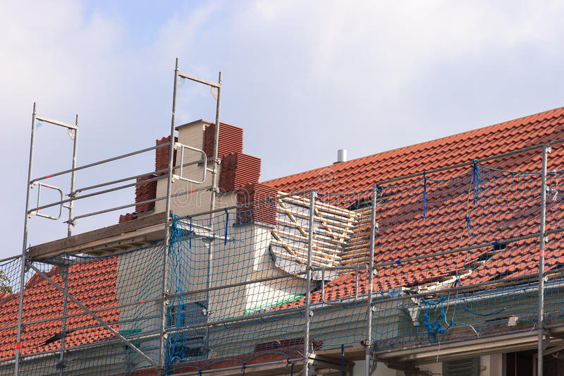 Repair a roof. Repair the roof of an old building royalty free stock photo