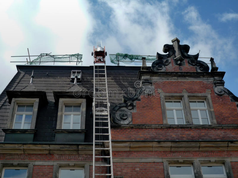 Repair a roof. Repair the roof of an old historical building royalty free stock images