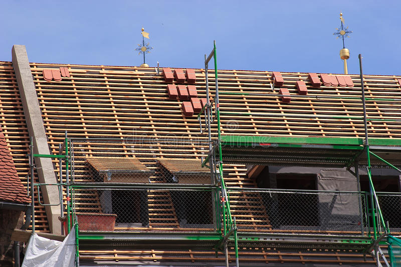 Repair a roof. Repair the roof of an old historical building stock images
