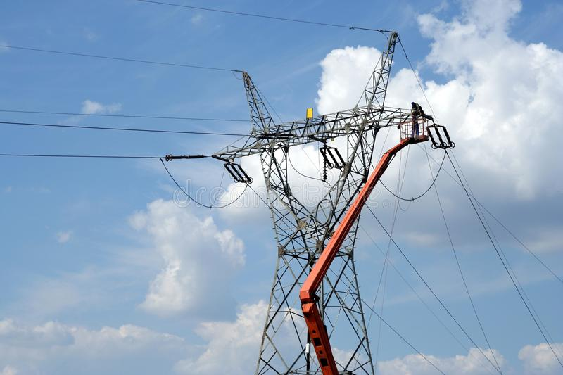 Download Repair Service On Power Pylon Stock Image - Image: 10487093