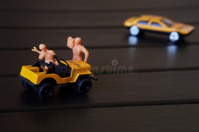Repair of a toy car in a toy workshop stock photography