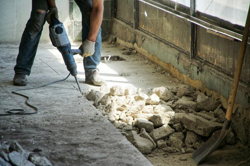 Repair using a perforator in a store or other public institution. Opening the cement floor royalty free stock photography