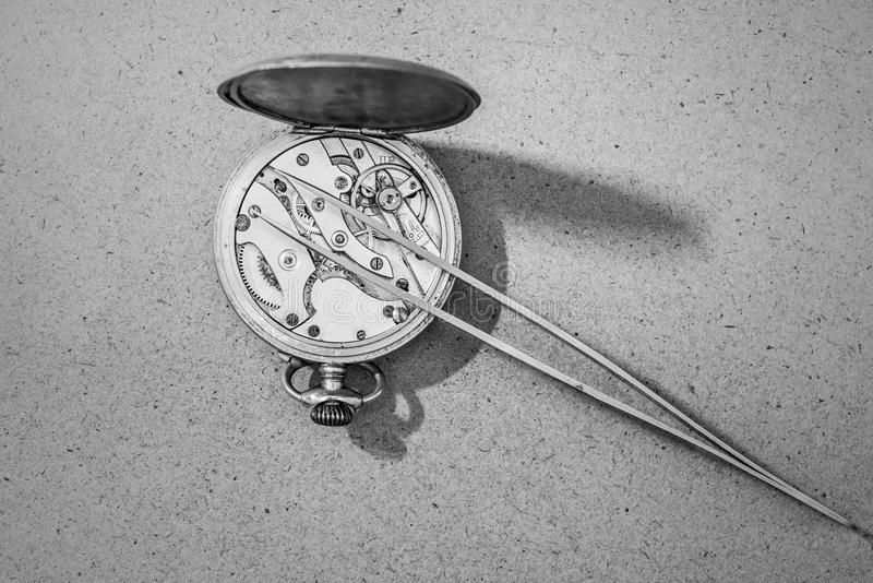 Repair of watches. Detail of clock parts for restoration stock images
