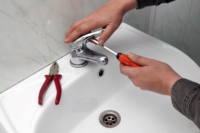 Repair of a water tap stock photo. Image of activity - 47294816