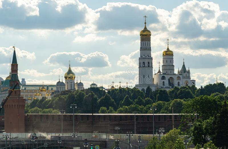 Repair work on Bolshoi Moskvoretsky bridge and walls of Kremlin. View of Ivan the Great Bell Tower of Moscow Kremlin stock images
