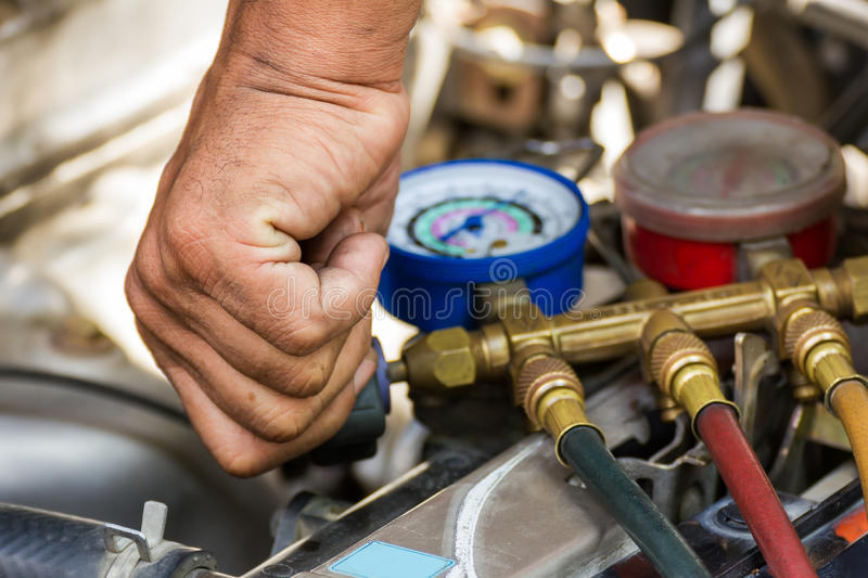 Repaired air car components. Compressed air car components to be repaired stock photo