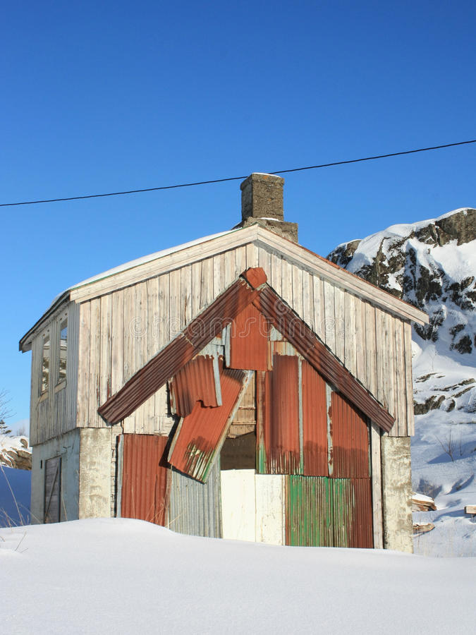 Repaired Lofoten's house. Old Lofoten's house repaired with iron sheets stock photos