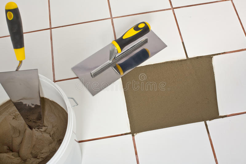 Download Repaired Old White Tiles Floor With Trowel Stock Image - Image: 25670741