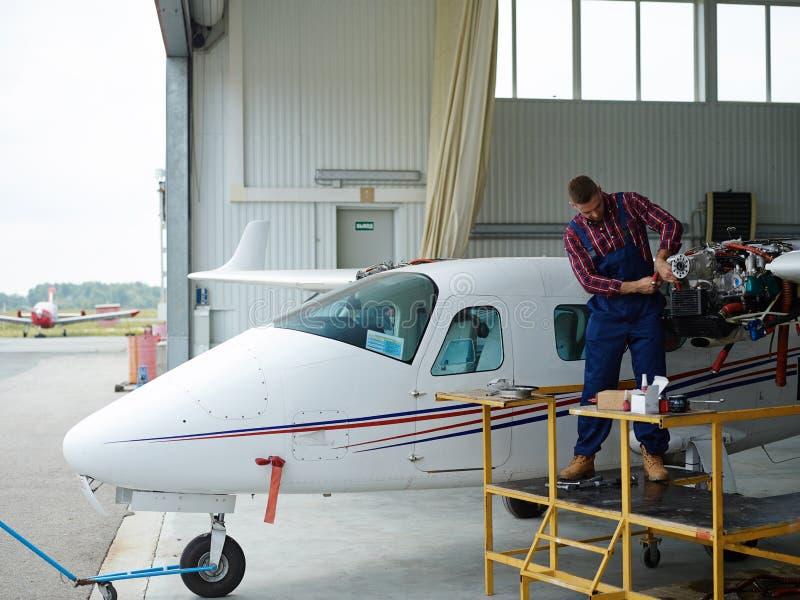 Repairing airplane stock photos