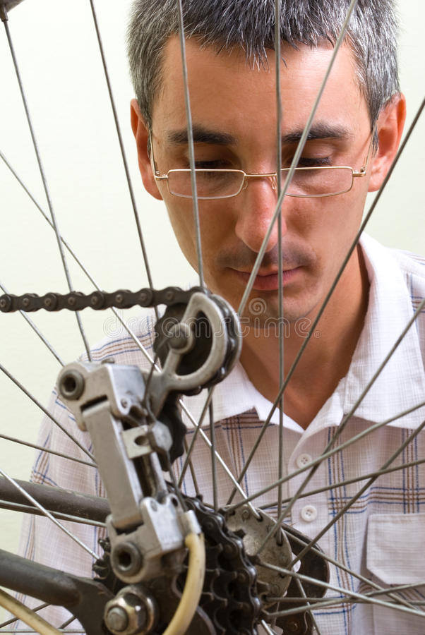 Repairing bike. Service for bike with adept repairing bike stock photos