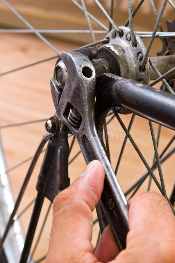 Repairing bike. Service for bike with adept repairing bike stock photo