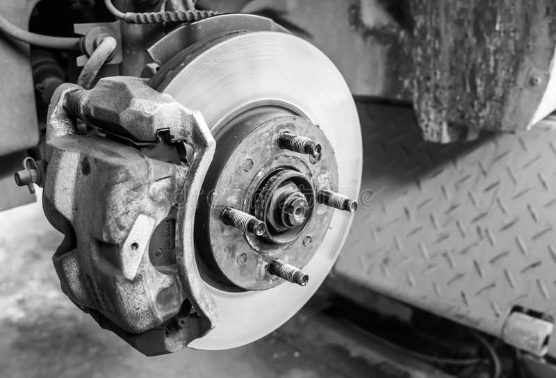 Repairing brakes car. Repairing brakes on car by monochromatic royalty free stock photos