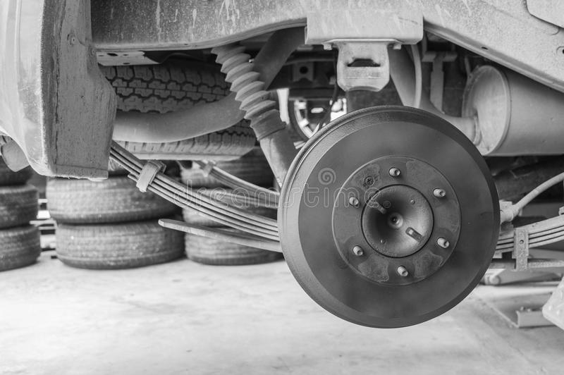 Repairing brakes car. Repairing brakes on car by monochromatic stock photo
