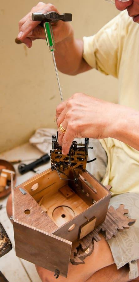 Repairing a Cuckoo Clock royalty free stock photography