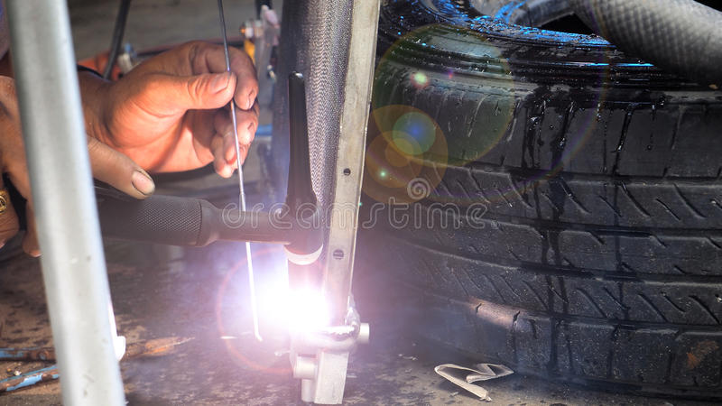 Repairing man made welding steel of valve auto air conditioning royalty free stock images