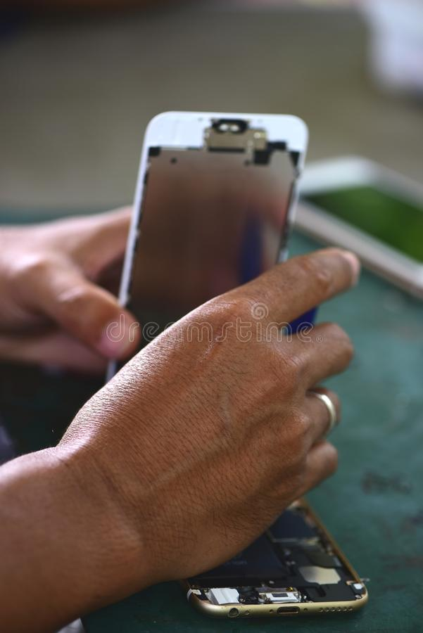 Repairing mobile phones and tablets by skilled technicians. stock image