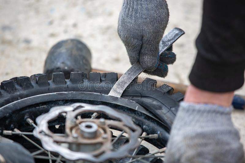 Repairing motorcycle tire with repair kit, Tire plug repair kit for tubeless tires. Repairing motorcycle tire with repair kit, Tire plug repair kit for tubeless stock image