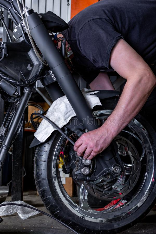 Repairing motorcycle tire with repair kit, Tire plug repair kit for tubeless tires. Repairing motorcycle tire with repair kit, Tire plug repair kit for tubeless royalty free stock photography